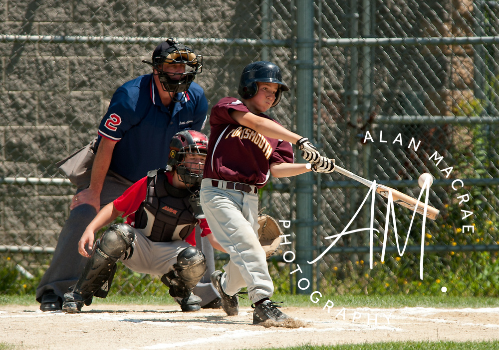 Portsmouth's Danny Philbrick lines up to drive the ball over the center field fence in the championship game against Laconia at Laconia's Colby Field on Sunday, July 18, 2010.  (Alan MacRae/for the Citizen)