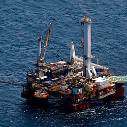 The Helix Energy Q4000 production platform prepares to begin the static kill procedure at the BP Plc MC252 well site in the Gulf of Mexico off the coast of Louisiana, U.S., on Monday, July 26, 2010. The 'static kill' option that involves pumping mud into the well to force oil back into the reservoir below. Photographer: Derick E. Hingle/Bloomberg