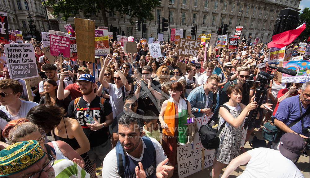 London, June 17th 2017. WARNING: LANGUAGE! Protesters demonstrate against the Conservative's intended alliance with the Democratic Unionist Party (DUP) in Whitehall, London. The proposed pact will enable the Tories to maintain a small level of dominance in the House of commons after their majority was wiped out in the June 8th general election.