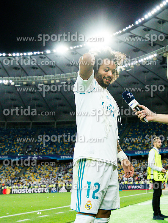 Marcelo of Real Madrid is interviewed after celebration after they won 3-1 during the UEFA Champions League final football match between Liverpool and Real Madrid and became Champions League  2018 Champions third time in a row at the Olympic Stadium in Kiev, Ukraine on May 26, 2018.Photo by Andriy Yurchak / Sportida
