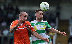 Jack Compton of Yeovil Town challenges for the high ball with Scott Cuthbert of Luton Town - Photo mandatory by-line: Harry Trump/JMP - Mobile: 07966 386802 - 22/08/15 - SPORT - FOOTBALL - Sky Bet League Two - Yeovil Town v Luton Town - Huish Park, Yeovil, England.