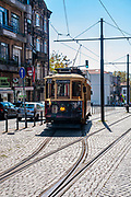 Old style heritage tram at Batalha Square (Praca da Batalha) in Se civil parish of Porto, Portugal