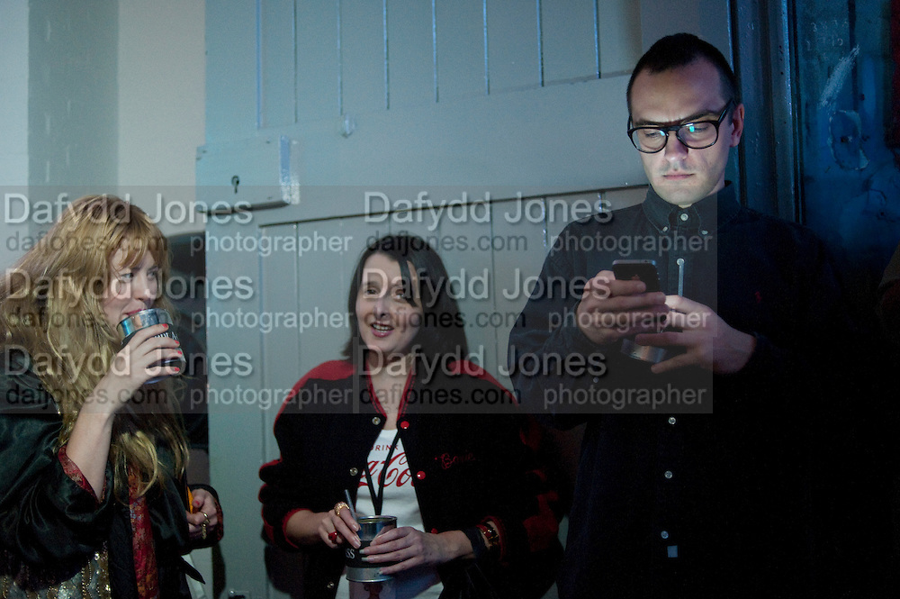 PHILIPPA HORAN; JAONNE FURNISS; DARYOUSH HAJ-NAJAFI, Giles Deacon after-show party. Elm lester painting rooms. Leicester Sq. London. 19 September 2011. <br /> <br />  , -DO NOT ARCHIVE-© Copyright Photograph by Dafydd Jones. 248 Clapham Rd. London SW9 0PZ. Tel 0207 820 0771. www.dafjones.com.
