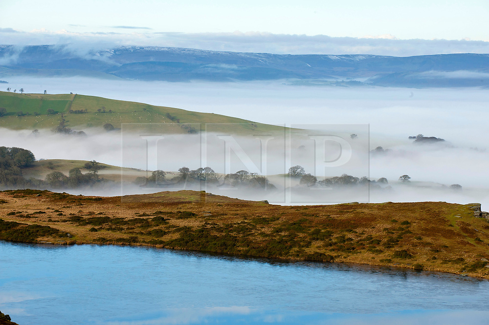 © Licensed to London News Pictures. 17/12/2019. Builth Wells, Powys, UK. A sea of cloud surrounds the landscape on the Mynydd Epynt range near Builth Wells in Powys after temperatures dropped  to below freezing last night. Photo credit: Graham M. Lawrence/LNP