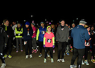 East Meadow, New York, USA. December 31, 2014. ALYSSA PAGANO, of Ellenville, wearing bright pink and yellow shirts, is one of the runners who will participate in a 5K New Year's Eve DASH to support the Long Island Council on Alcoholism and Drug Dependence (LICADD) at the Twin RInks Ice Center at Eisenhower Park in Long Island. A Skatin' New Year's Eve event started hours earlier and a New Year's Eve Party, open to runners, family and friends continued until 2:30 a.m.
