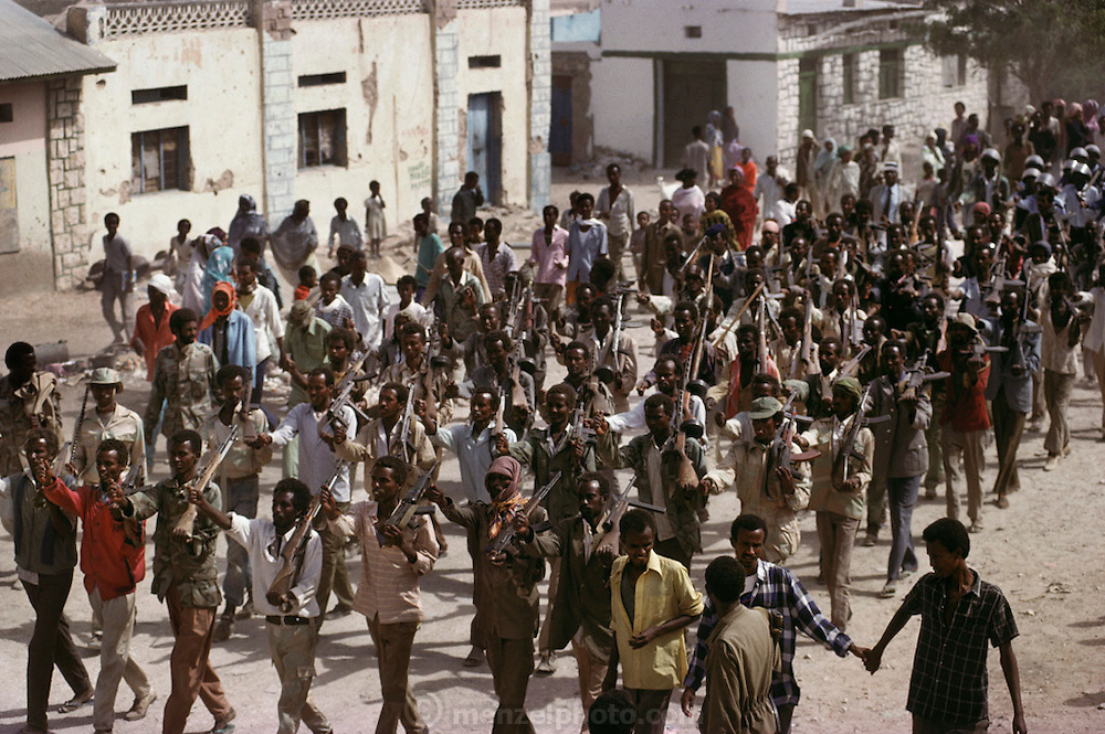 A military parade of the Somali National Movement marches in a display of unity in Hargeisa, Somaliland. Forces usually stay outside town in barracks. Somaliland is the breakaway republic in northern Somalia that declared independence in 1991 after 50,000 died in civil war. March 1992.