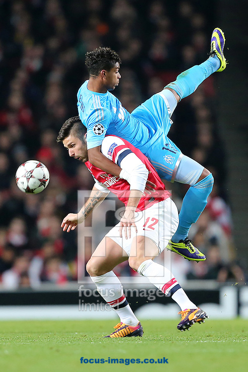 Picture by Richard Calver/Focus Images Ltd +447792 981244<br /> 26/11/2013<br /> Olivier Giroud of Arsenal and Mario Lemina of Olympique de Marseille get in a tangle during the UEFA Champions League match at the Emirates Stadium, London.