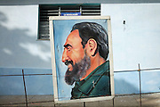A portrait of Fidel tied to the outside of a school in Martí, Cuba.