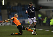 Bruno Saltor, Brighton defender slide tackle during the Sky Bet Championship match between Millwall and Brighton and Hove Albion at The Den, London, England on 17 March 2015.