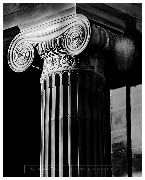 Black and white photograph of Ionic column in Glasgow. Mounted print available to purchase.