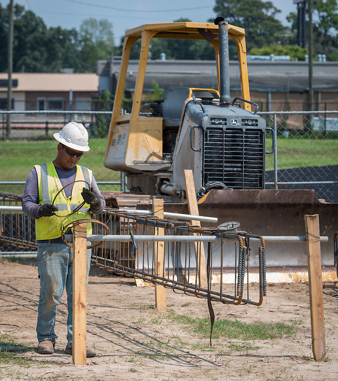 Contractors work on projects at Waltrip High School, September 22, 2014.