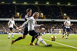 Christian Eriksen of Tottenham Hotspur clears from Muhamed Besic of Everton - Photo mandatory by-line: Rogan Thomson/JMP - 07966 386802 - 30/11/2014 - SPORT - FOOTBALL - London, England - White Hart Lane - Tottenham Hotspur v Everton - Barclays Premier League.