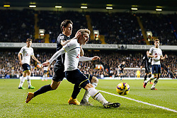 Christian Eriksen of Tottenham Hotspur clears from Muhamed Besic of Everton - Photo mandatory by-line: Rogan Thomson/JMP - 07966 386802 - 30/11/2014 - SPORT - FOOTBALL - London, England - White Hart Lane - Tottenham Hotspur v Everton - Barclays Premier League.