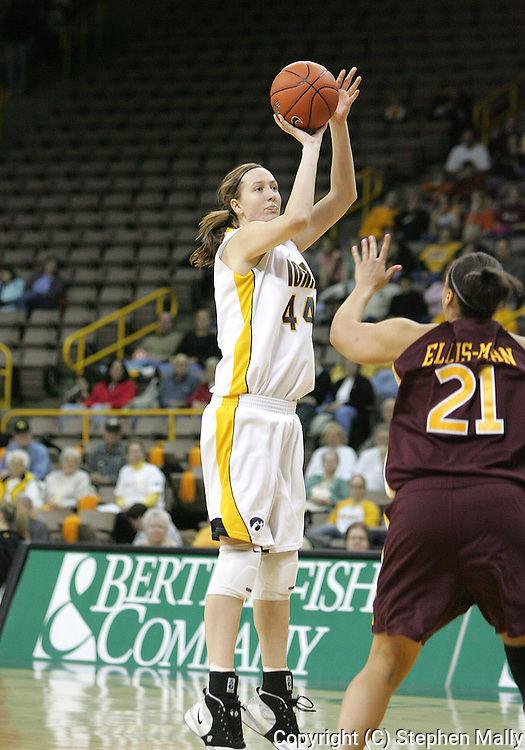 25 JANUARY 2007: Iowa center Megan Skouby (44) takes a shot over Minnesota forward/center Ashley Ellis-Milan (21) in Iowa's 80-78 overtime loss to Minnesota at Carver-Hawkeye Arena in Iowa City, Iowa on January 25, 2007.
