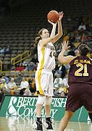 25 JANUARY 2007: Iowa center Megan Skouby (44) takes a shot over Minnesota forward/center Ashley Ellis-Milan (21) in Iowa's 80-78 overtime loss to Minnesota at Carver-Hawkeye Arena in Iowa City, Iowa on January 25, 2007.
