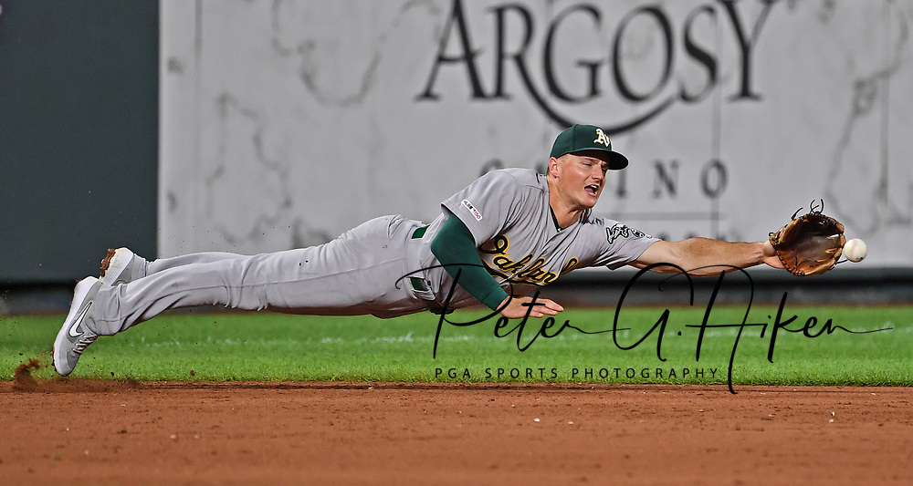 Oakland Athletics third baseman Matt Chapman (26) dives for a ground ball during the sixth inning against the Kansas City Royals at Kauffman Stadium.