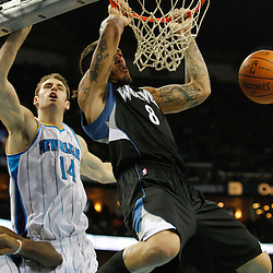 February 7, 2011; New Orleans, LA, USA; Minnesota Timberwolves power forward Michael Beasley (8) dunks over New Orleans Hornets power forward Jason Smith (14)  during the fourth quarter at the New Orleans Arena. The Timberwolves defeated the Hornets 104-92.  Mandatory Credit: Derick E. Hingle