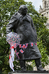 © Licensed to London News Pictures. 07/09/2019. London, UK. Union Jack buntings are draped around the Statue of Sir Winston Churchill in Parliament Square by the Pro Brexit protesters. Photo credit: Dinendra Haria/LNP