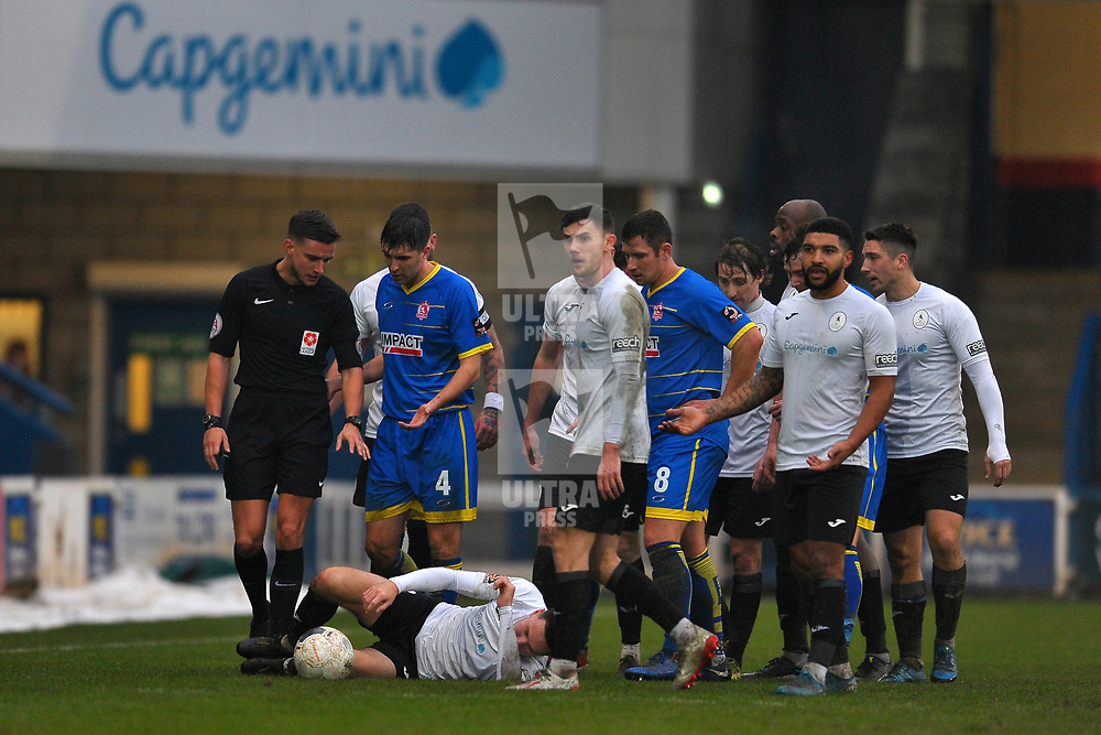 TELFORD COPYRIGHT MIKE SHERIDAN Telford players surround referee Thomas Kirk after Ryan Barnett is fouled during the Vanarama Conference North fixture between AFC Telford United and Alfreton Town at the New Bucks Head Stadium on Thursday, December 26, 2019.<br /> <br /> Picture credit: Mike Sheridan/Ultrapress<br /> <br /> MS201920-036