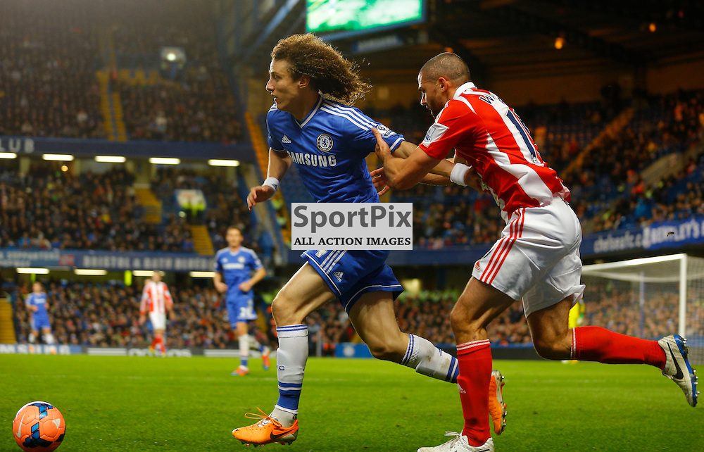 Stoke FW 19 Jonathan Walters pulls Chelsea DF 4 David Luiz back whilst battling for the Ball | Andy Walter (c) Sportpix.org