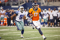 28 AUG 2014: Denver Broncos quarterback Brock Osweiler (17) runs for a 1st down while being chased by Dallas Cowboys Kenneth Boatright (91) during the final NFL American Football Herren USA preseason game between the Denver Broncos and Dallas Cowboys at AT&T Stadium in Arlington, TX. Denver defeats Dallas 27-3. NFL American Football Herren USA AUG 28 Preseason - Broncos at Cowboys PUBLICATIONxINxGERxSUIxAUTxHUNxRUSxSWExNORxONLY Icon1408281046<br />