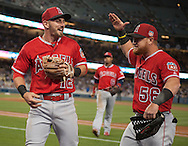 The Angels' Johnny Giavotella celebrates a nice play with Kole Calhoun during the Angels' Freeway Series game against the Dodgers Thursday night at Dodger Stadium.<br /> <br /> ///ADDITIONAL INFO:   <br /> <br /> freeway.0401.kjs  ---  Photo by KEVIN SULLIVAN / Orange County Register  --  3/31/16<br /> <br /> The Los Angeles Angels take on the Los Angeles Dodgers at Dodger Stadium during the Freeway Series Thursday.<br /> <br /> <br />  3/31/16