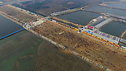 RIZHAO, CHINA - MARCH 12: (CHINA OUT) ]<br /> Aerial view of people planting trees along the bank on March 12, 2016 in Rizhao, Shandong Province of China. Over 50,000 people gathered and planted trees on Chinese Arbor Day in Rizhao. <br /> ©Exclusivepix Media