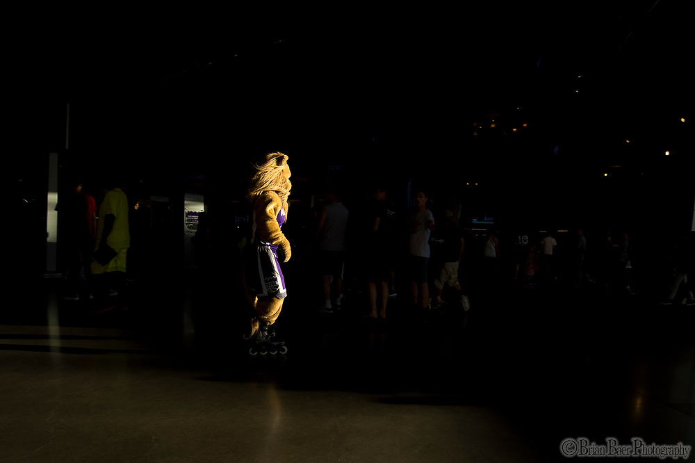 Kings mascot, Slamson moves through the ground on rollerblades as fans enter Golden One Center to watch the Kings Lakers Sumer League game, Monday Jul 10, 2017.<br /> photo by Brian Baer