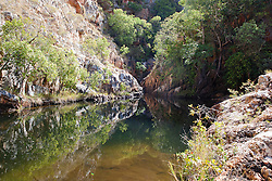 A remote and secluded freshwater swimming hole in Dugong Bay on the Kimberley coast.