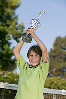 Boy Holding Tennis Trophy