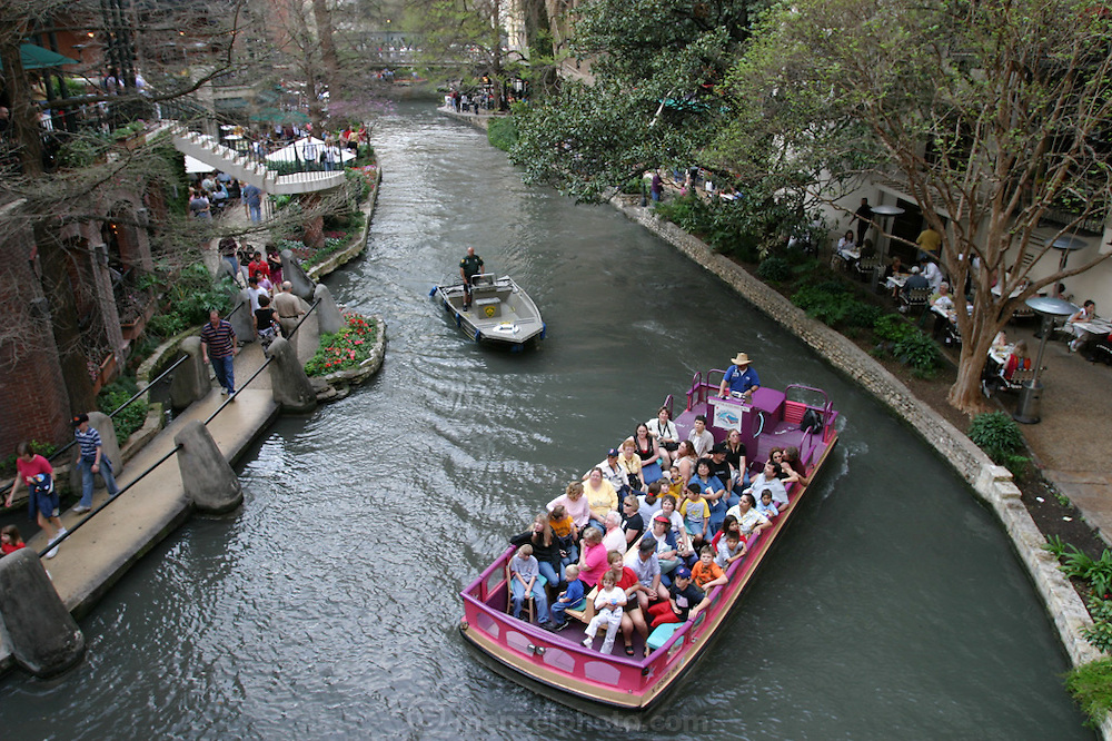 The River Walk along the San Antonio River in downtown San Antonio, Texas.
