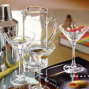 martini glassware and shaker on table setting