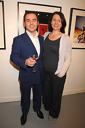 CHRIS & SILVIA WESTBROOK at an exhibition of photographs by Madeleine Farley entitled 'Cameos' held at the Westbrook Gallery, 8 Windmill Street, London W1 on 14th February 2008. <br />
