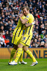 Harry Kane of Tottenham Hotspur celebrates with Kyle Walker after scoring a goal to make it 0-2 - Photo mandatory by-line: Rogan Thomson/JMP - 07966 386802 - 31/01/2015 - SPORT - FOOTBALL - West Bromwich, England - The Hawthorns - West Bromwich Albion v Tottenham Hotspur - Barclays Premier League.