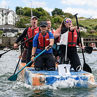 REPRO FREE<br /> The Atlantic Offshore/White House raft on it's way to winning the RNLI Raft Race in Kinsale on Saturday of the Bank Holiday Weekend<br /> Picture. John Allen