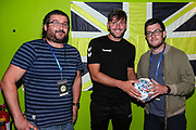 Match sponsors Fat Toni's Pizza receive a signed match ball from man of the match Forest Green Rovers goalkeeper James Montgomery during the Pre-Season Friendly match between Forest Green Rovers and Leeds United at the New Lawn, Forest Green, United Kingdom on 17 July 2018. Picture by Shane Healey.