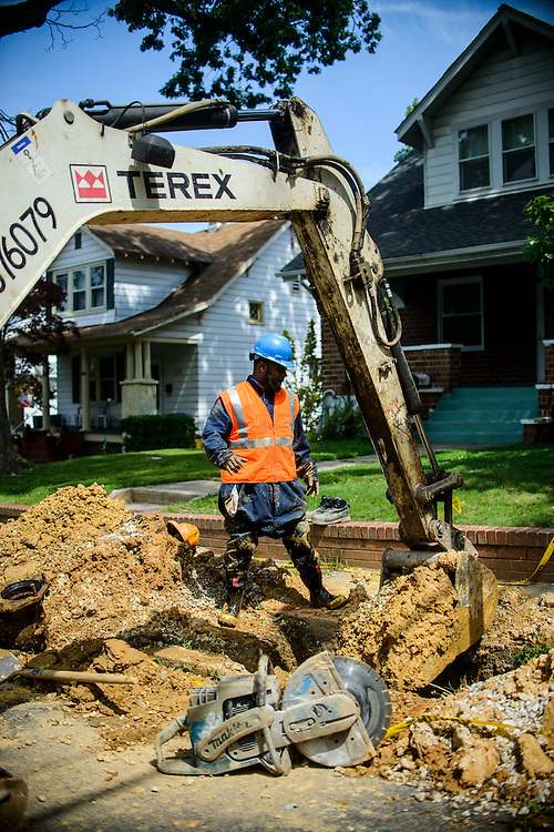 Photo by Matt Roth<br /> <br /> Charles Lee, laborer,<br /> Nathaniel Copeland, site supervisor,<br /> Stanley Maith, back how operator<br /> <br /> Baltimore City Department of Public Works employees replace a fire hydrant at the intersection of Tyndale Ave., and Canfield Ave. in Baltimore, Maryland on Wednesday, May 29, 2013.