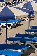 Sunlounger and parasol on beach, Tabarca island, Alicante, Spain
