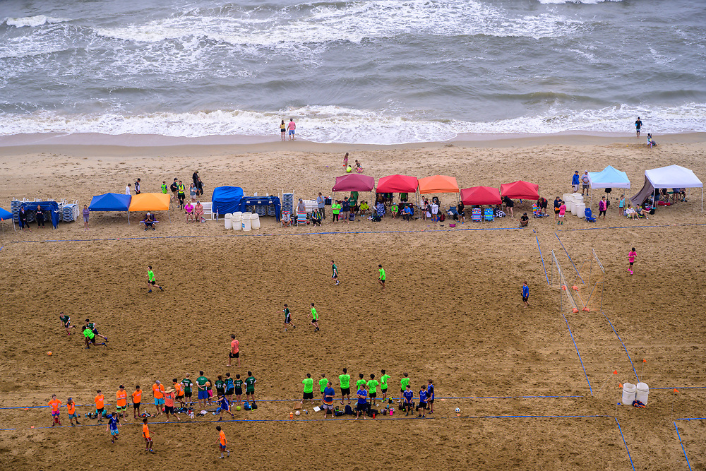 Virginia Beach, VA, USA -- June 8, 2019.  A photo overlooking a match in progress in the annual sand soccer tournament held in Virginia Beach.