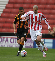Photo: Pete Lorence.<br />Stoke City v Hull City. Coca Cola Championship. 21/04/2007.<br />Danny Higginbotham charges ahead of <br />Nicky Forster.