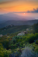 Sunset over Santa Ynez Peak, and the distant Lake Cachuma, from the Santa Ynez Mountains, near Santa Barbara, California
