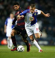 Photo: Paul Greenwood/Sportsbeat Images.<br />Blackburn Rovers v Arsenal. Carling Cup, Quarter Final. 18/12/2007.<br />Blackburn's David Bentley, (L) battles with Arsenal's Denilson