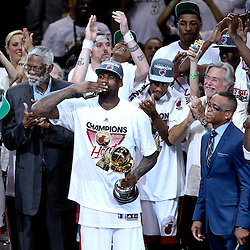 Jun 21, 2012; Miami, FL, USA; Miami Heat small forward LeBron James (6) blows a kiss to the fans as the team celebrated after winning the NBA championship in game five of the 2012 NBA Finals against the Oklahoma City Thunder at the American Airlines Arena. Miami won 121-106. Mandatory Credit: Derick E. Hingle-US PRESSWIRE