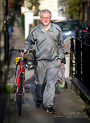 © Licensed to London News Pictures. 28/11/2015. London, UK. Labour Party leader JEREMY CORBYN  pushing his bike while leaving home in Islington, north London this morning (Sat). Jeremy Corbyn has come under pressure from his own party over a potential vote on UK military involvement in Syria. Photo credit: Ben Cawthra/LNP