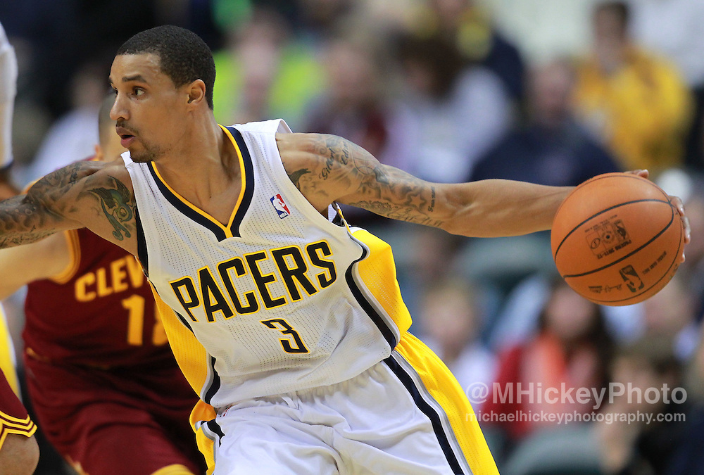 Dec. 30, 2011; Indianapolis, IN, USA; Indiana Pacers point guard George Hill (3) dribbles the ball against the Cleveland Cavaliers at Bankers Life Fieldshouse. Indiana defeated Cleveland 81-91. Mandatory credit: Michael Hickey-US PRESSWIRE