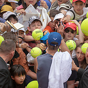 PARIS, FRANCE May 25. Rafael Nadal of Spain instructs the fans to live back as he signs autographs after his training session on Court Suzanne Lenglen in preparation for the 2019 French Open Tennis Tournament at Roland Garros on May 25th 2019 in Paris, France. (Photo by Tim Clayton/Corbis via Getty Images)