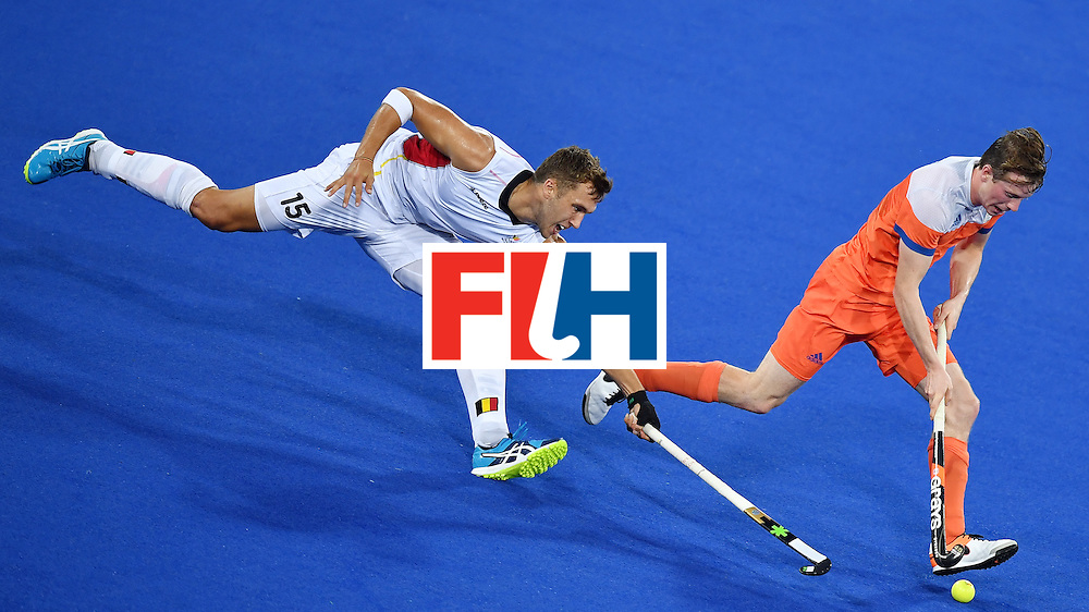 Belgium's Emmanuel Stockbroekx (L) chases Netherland's Seve van Ass during the men's semifinal field hockey Belgium vs Netherlands match of the Rio 2016 Olympics Games at the Olympic Hockey Centre in Rio de Janeiro on August 16, 2016. / AFP / MANAN VATSYAYANA        (Photo credit should read MANAN VATSYAYANA/AFP/Getty Images)