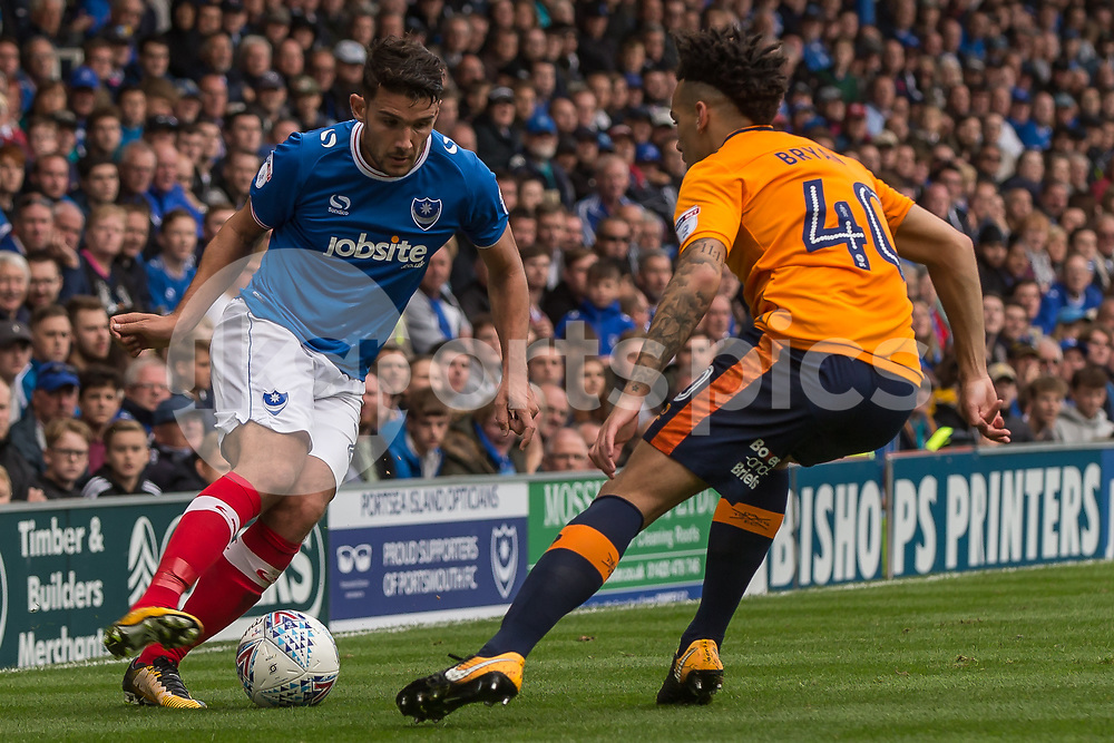Gareth Evans of Portsmouth  takes on Kean Bryan of Oldham Athletic during the EFL Sky Bet League 1 match between Portsmouth and Oldham Athletic at Fratton Park, Portsmouth, England on 30 September 2017. Photo by Simon Carlton.