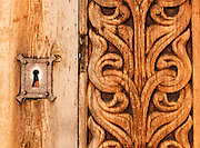 """Keyhole and wood carving. Heddal stave church is Norway's largest stave church. This triple nave stave church, which some call """"a Gothic cathedral in wood,"""" was built in the early 13th century and restored in 1849-1851 and the 1950s. Heddal stavkirke is in Notodden municipality, Telemark County, Norway."""