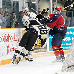 TRENTON, - Mar 20, 2016 -  Ontario Junior Hockey League game action between the Trenton Golden Hawks and the Wellington Dukes. Game 2 of the semi final playoff series, Carter Allen #2 of the Wellington Dukes makes the hit on Hunter Fargey #88 and Danny Hanlon #27 of the Trenton Golden Hawks during the third period at the Duncan Memorial Gardens, ON. (Photo by Amy Deroche / OJHL Images)
